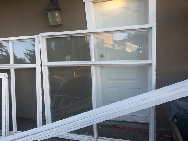 Used double pane windows and 2 sets of French doors