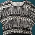 LADIES BLACK AND WHITE RICKIS REVOLUTION TOP SIZE LARGE 12/14