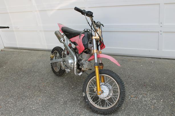 2009 (?) 110cc dirt dike. New back tire.