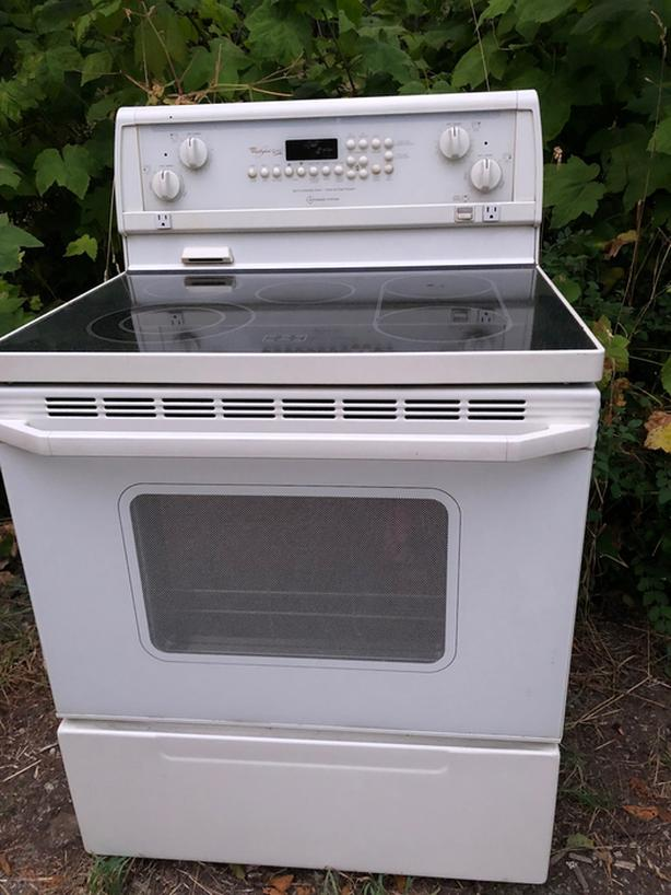 Off White coloured Stove