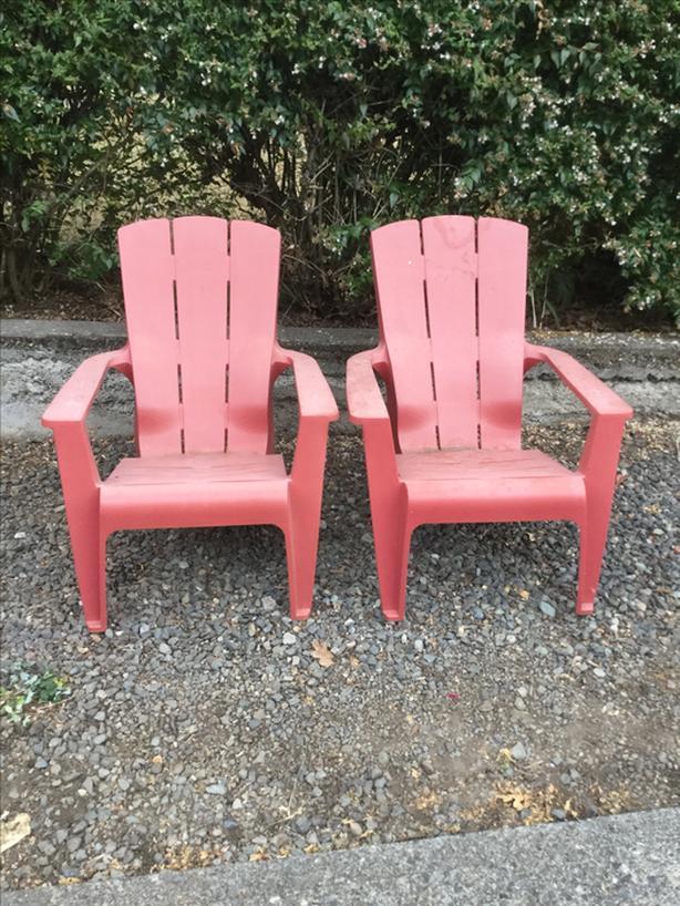 Pair Red Plastic Adirondack Chairs