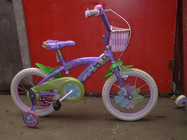2 CHILDRENS BIKES WITH TRAINING WHEELS