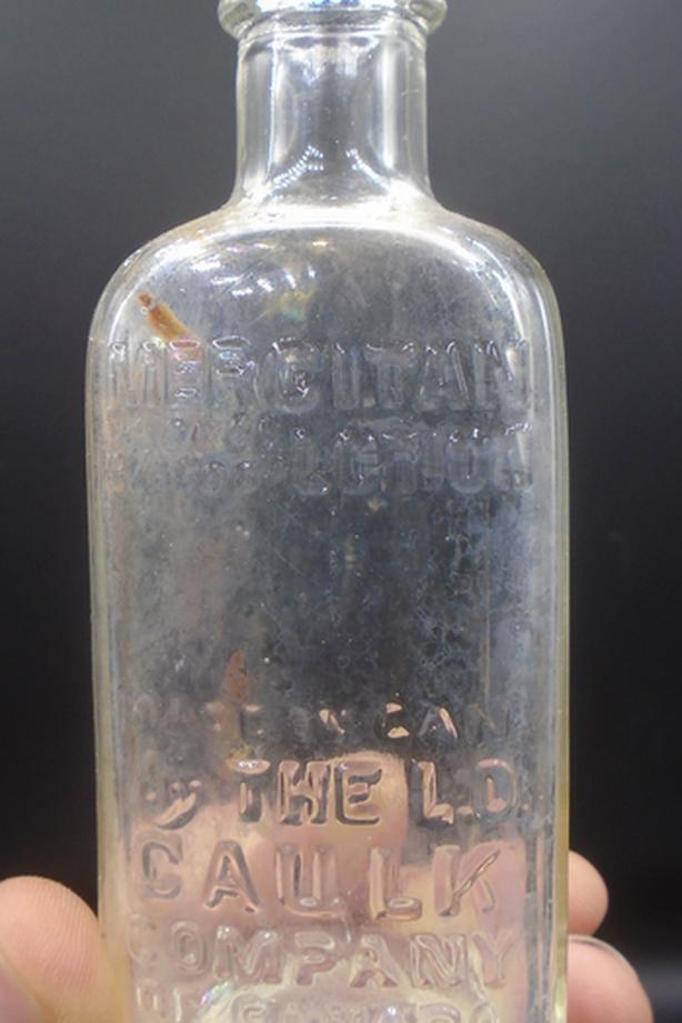 VINTAGE 1940's MERCITAN MOUTH & THROAT LOTION EMBOSSED BOTTLE