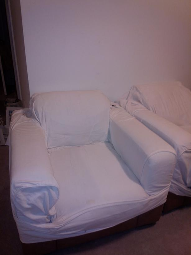 2 chairs  with a cover