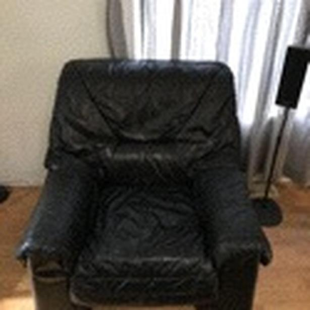 Black faux leather chair and love seat