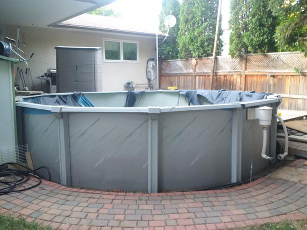 Above ground swimming pool with attachments