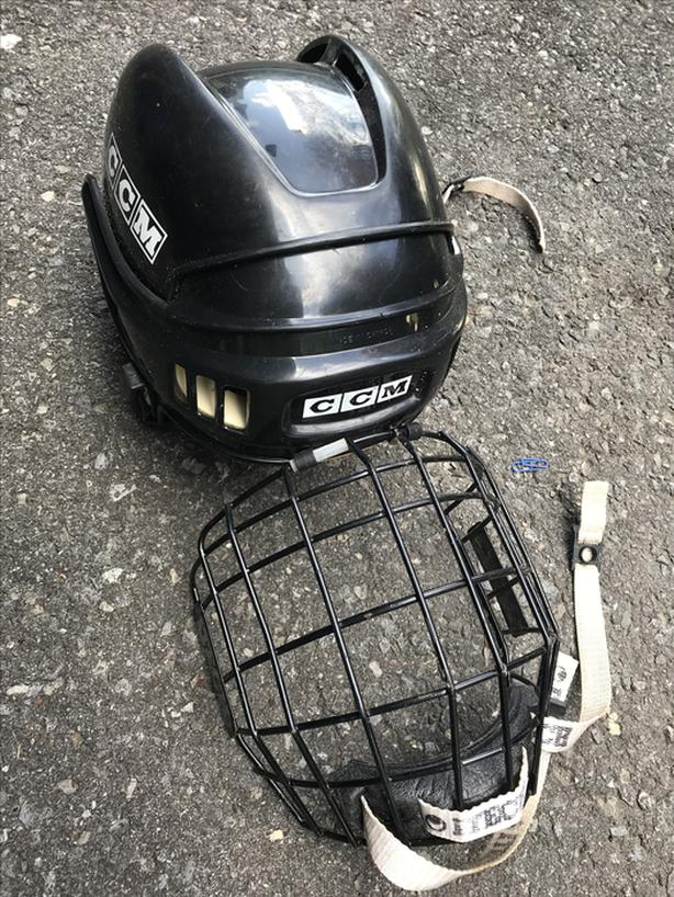 CCM hockey helmet with gage mask