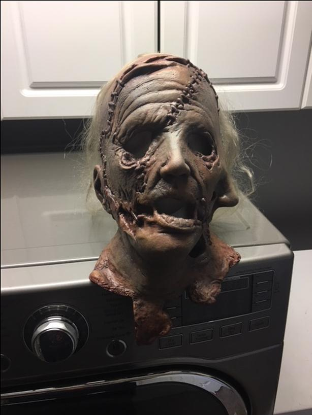 Various high end Halloween masks, Some with tags.