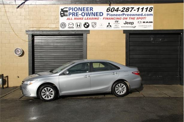 2015 Toyota Camry LE   INFOTAINMENT SYSTEM INCLUDES BACK UP CAM