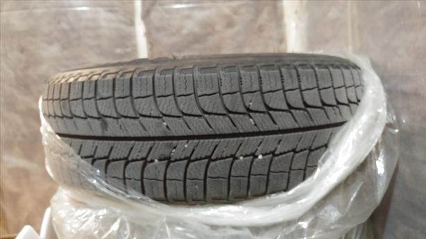 A set of 4 New X-Ice Xi3 Michelin Winter Tires on Rims