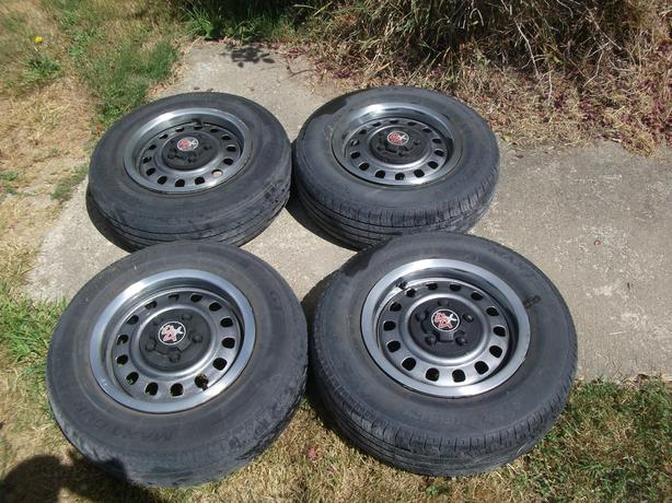 FOUR 205/75R/15 RIMS AND TIRES