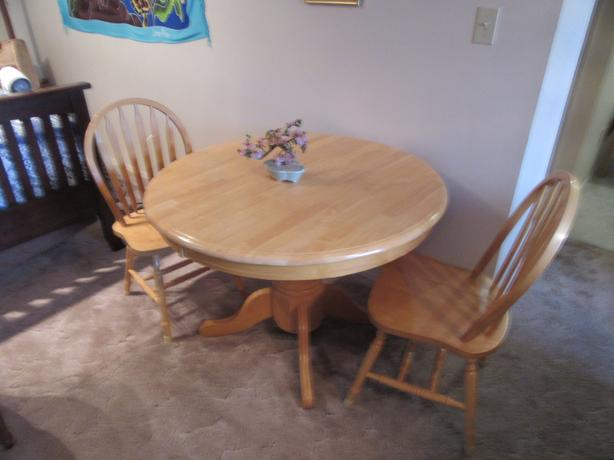 "42"" table with 16"" fold out leaf with two chairs"