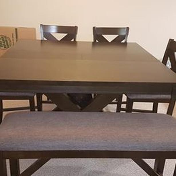Solid wood table with 4 chairs and a bench