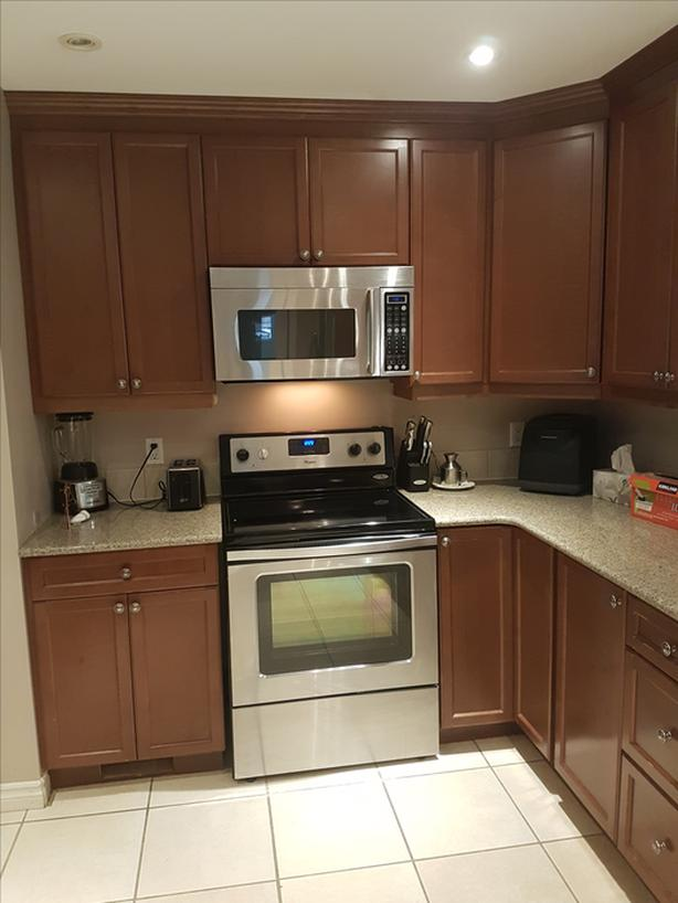 Solid Wood Cabinets With Granite Countertops