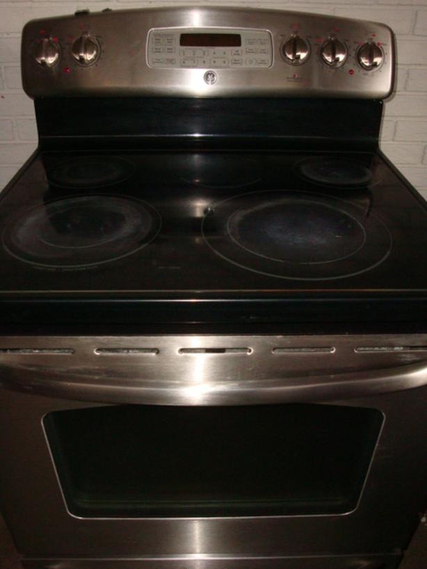 GE flat top stainless steel stove,self clean,convection oven