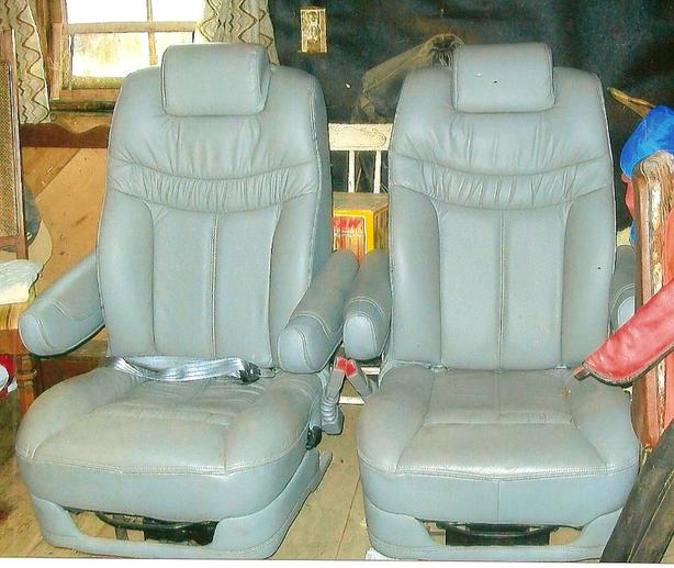 2 leather captain chairs