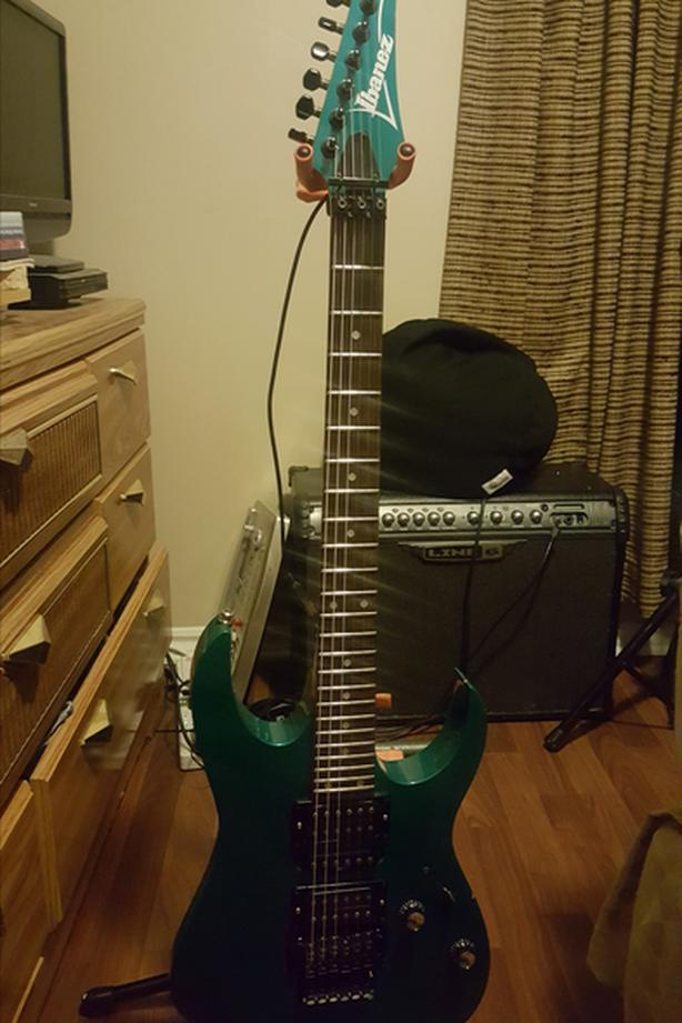 Used Green Ibanez RG570 6 String Electric Guitar for Sale