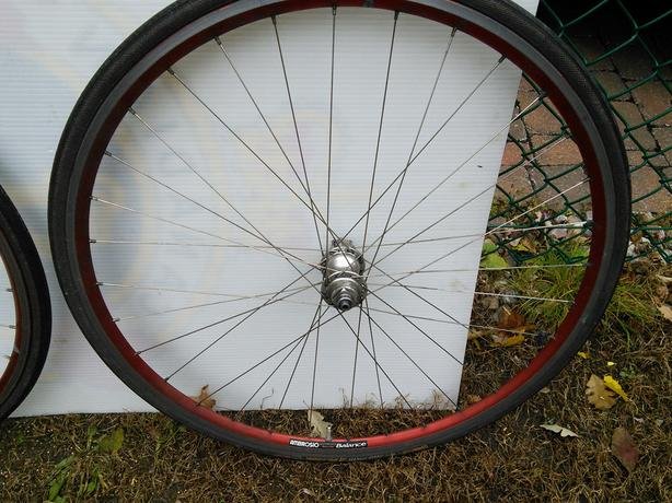TWO RIMS & RUBBERS