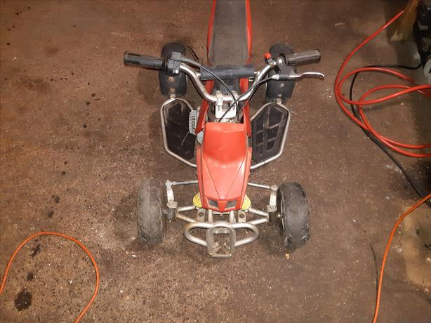 mini gas powered 4 wheeler