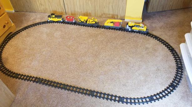 Caterpillar toy train and tracks