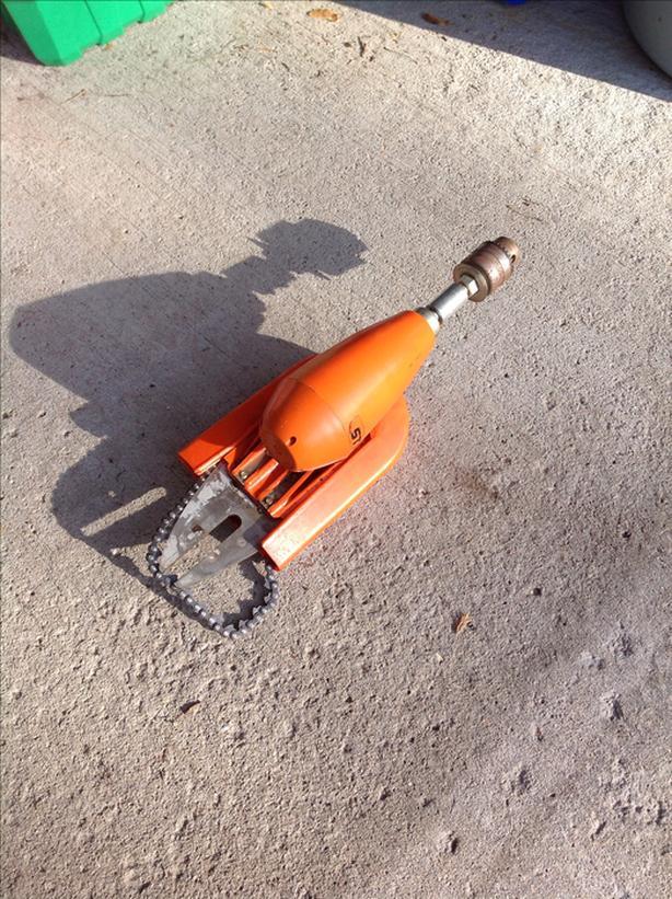 Chainsaw drill attachment