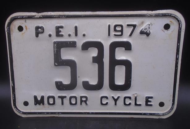 VINTAGE P.E.I. MOTOR CYCLE LICENSE PLATE CIRCA 1974