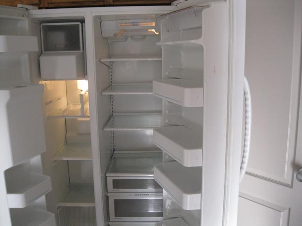 White side by side maytag refrigerator in good working condition.