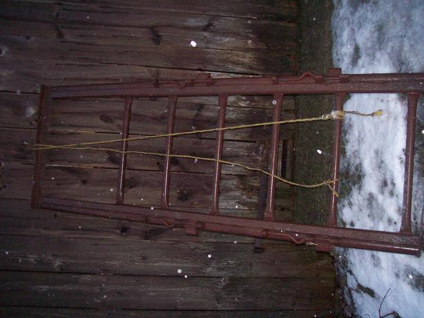 Cattle chute drop gate