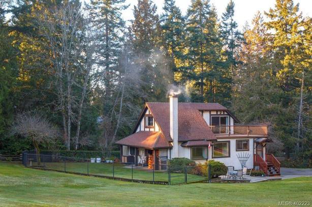 4 acres | 4BR | 3BA | $989K | Triple Garage | Detached Shop