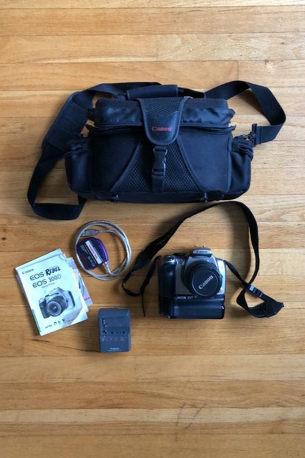 Canon Rebel with battery pack, bag, 18-55mm lens.