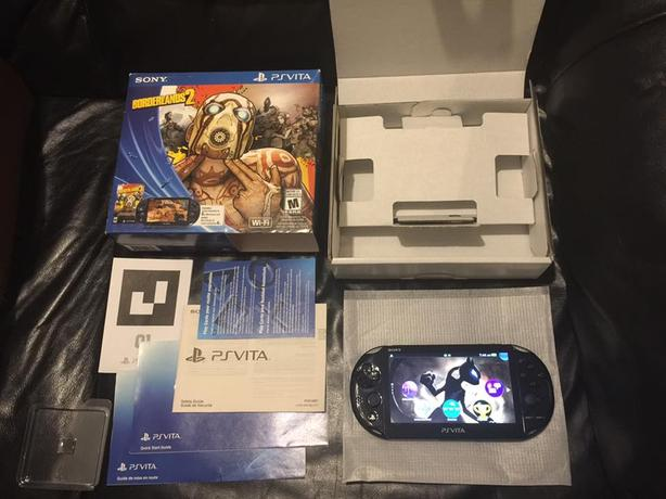 Ps Vita in box with 8gb memory card and homebrewed