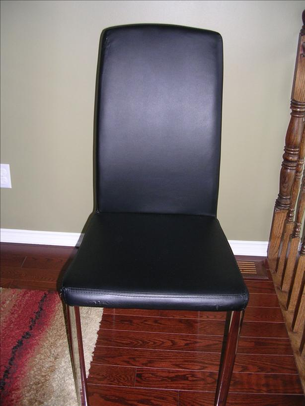 4 Black vinyl chairs with chrome legs