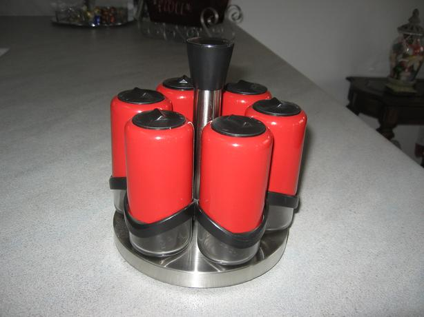Bright Red Glass Spice Bottles in Stainless Steel Rack Lazy Susan style
