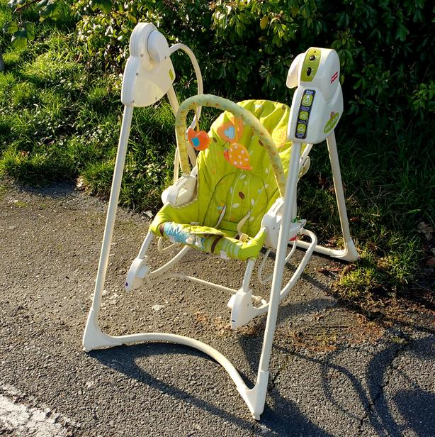 FREE:  baby rocker, curbside Kenneth & Raymond St North