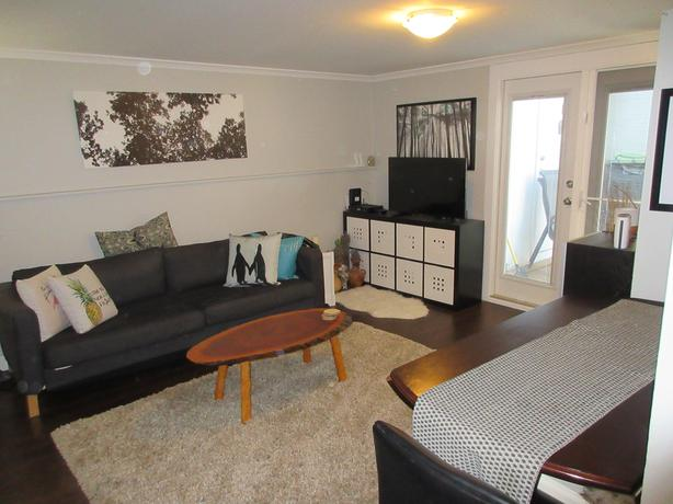 """Best """"walk-to-work"""" location – above ground 1BD residence"""