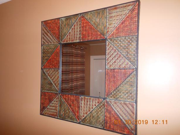 Geometric wall mirror - like new w/metal candle holder