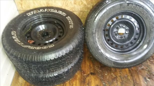 NEED A SPARE SET OF TIRES WITH RIMS?