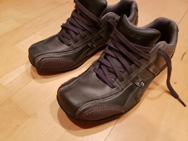 New size 9.5 men's leather Sketchers.