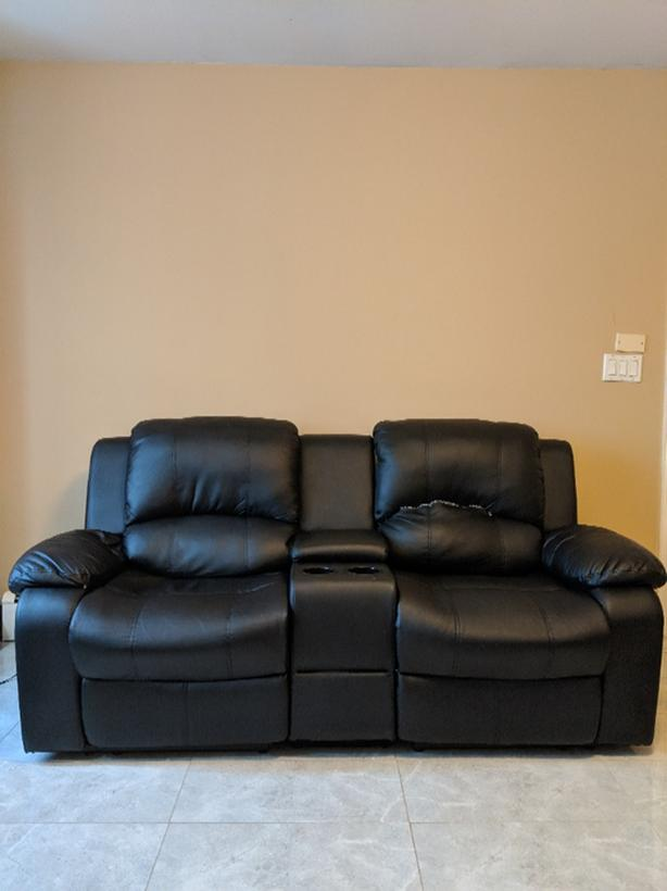 Modern recliner sofa with centre storage plus loveseat.