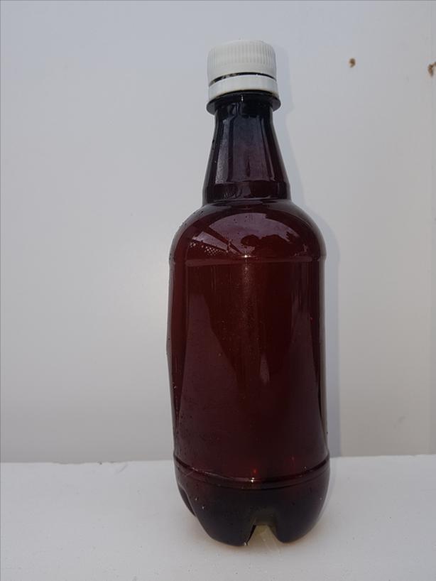 FREE: Brown plastic beer bottles.