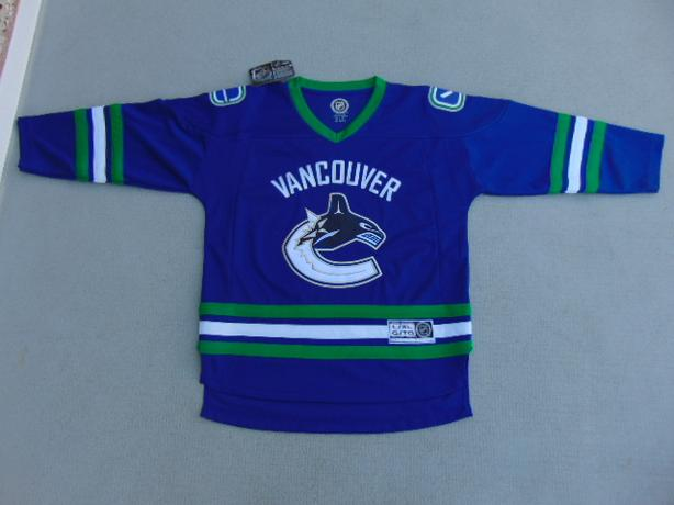 Hockey Jersey Child Size Large X Large 12-14 NHL Canucks  New With Tags