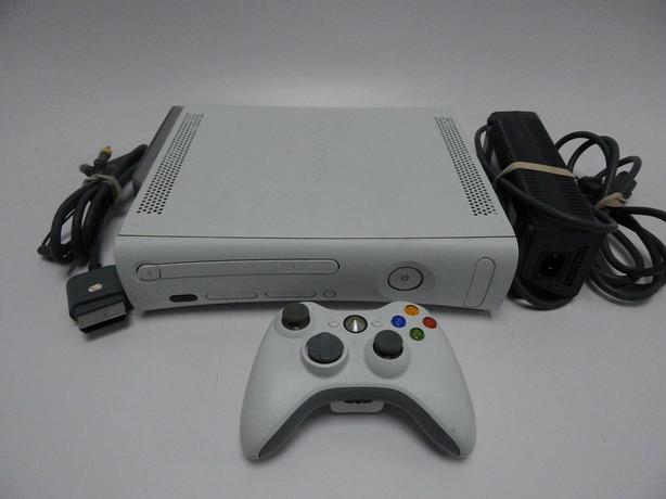 Xbox 360 Console, (3) whirles cotrollers-  (5) games