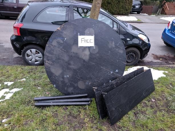 FREE: Round Black Extendable Table.