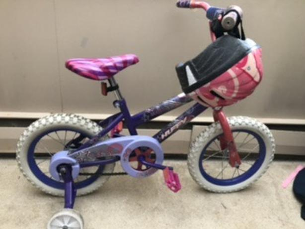 Girls bike with training wheels and helmet