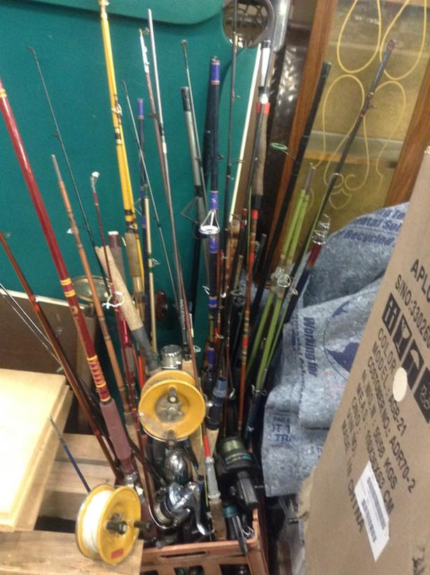 Variety of fishing rods and reels.