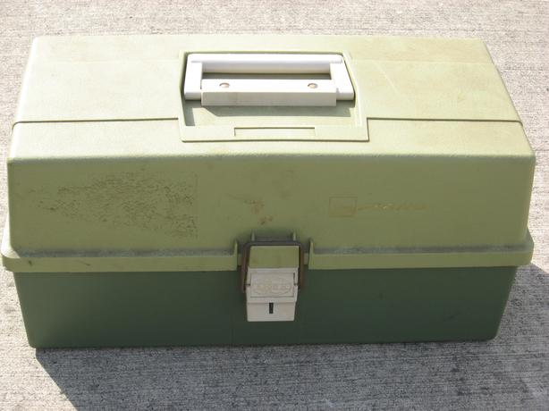 Saltwater fishing tackle box with contents