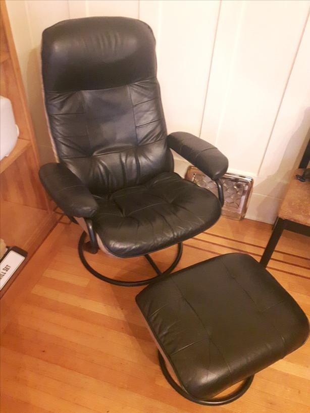 Black recliner chair with stool