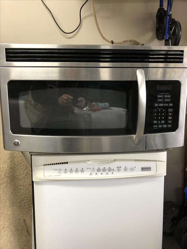 GE MICROWAVE STAINLESS STEEL  (OVER THE RANGE STYLE)