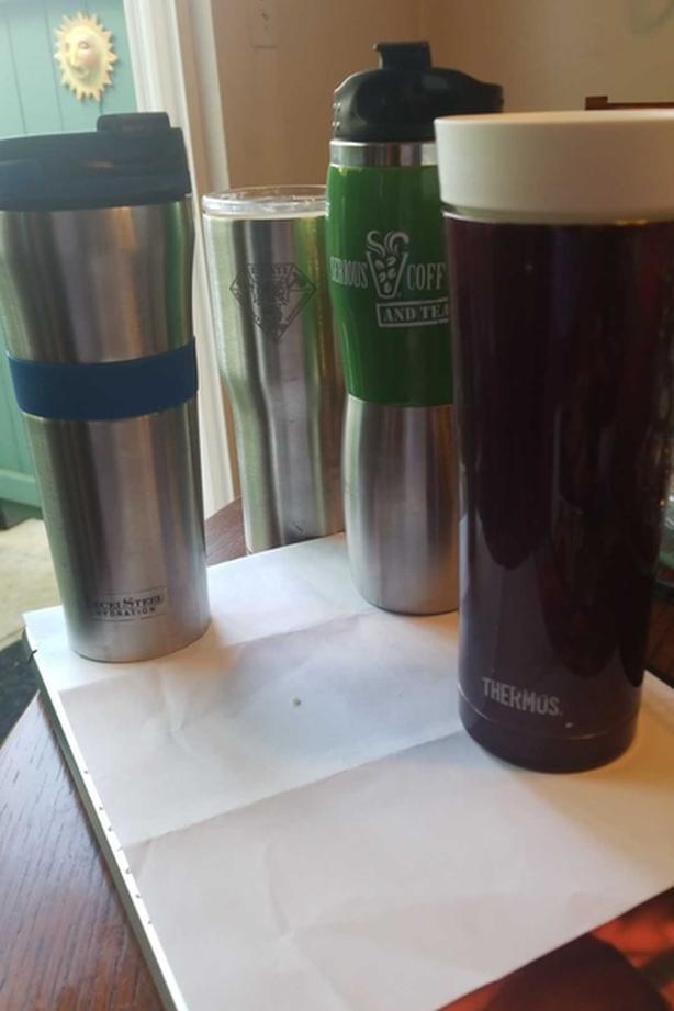 4 stainless coffee / tea tumblers. EUC.
