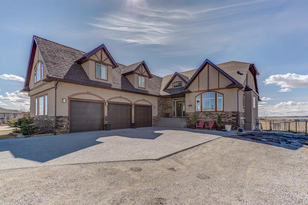 Stunning walkout bungalow with heated triple garage!